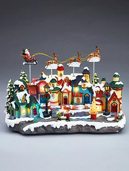 led-christmas-village-with-moving-reindeers