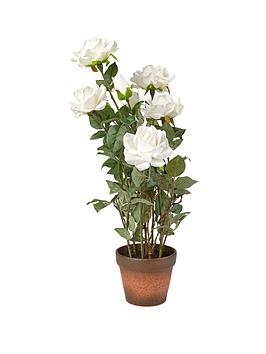 artificial-white-roses-in-a-terracotta-pot