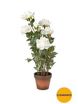 artificial-white-roses-in-a-terracotta-pot