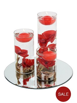 hestia-set-of-3-floating-candles-with-vases-and-red-flowers-on-a-mirrored-base