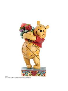 disney-traditions-winnie-the-pooh-with-flowers-figurine