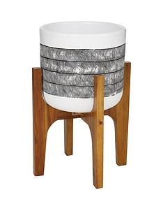 patterned-pot-on-wooden-legs-black-and-white