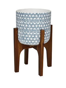 patterned-potnbsp-on-wooden-legs-blue-and-white