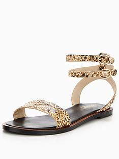 dune-lagoma-studded-flat-sandal-snake-print