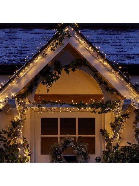 festive-1000-multi-function-warm-white-indooroutdoor-cluster-christmas-fairy-lights-with-timer