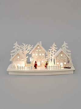 white-wood-lit-village-scene-christmas-decoration