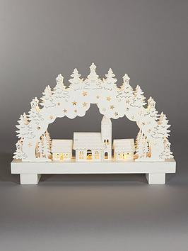 white-wood-lit-candle-bridge-scene-christmas-decoration