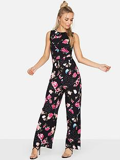 girls-on-film-girls-on-film-splicing-foral-spot-sleeveless-jumpsuit