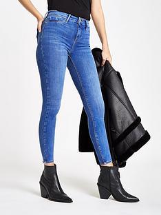 15f823f00fef1 River Island River Island Regular Leg Super Skinny Jeans - Light Blue