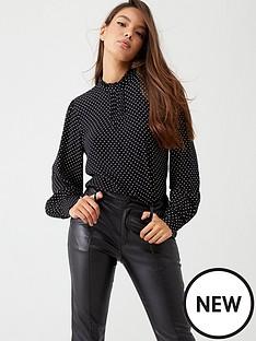 warehouse-pinspot-high-neck-top-black