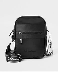 river-island-black-prolific-tape-zip-front-backpack