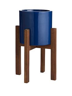 blue-ceramic-planter-on-wooden-stand