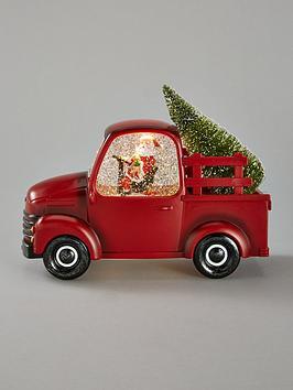 festive-red-santa-car-with-tree-christmas-decoration