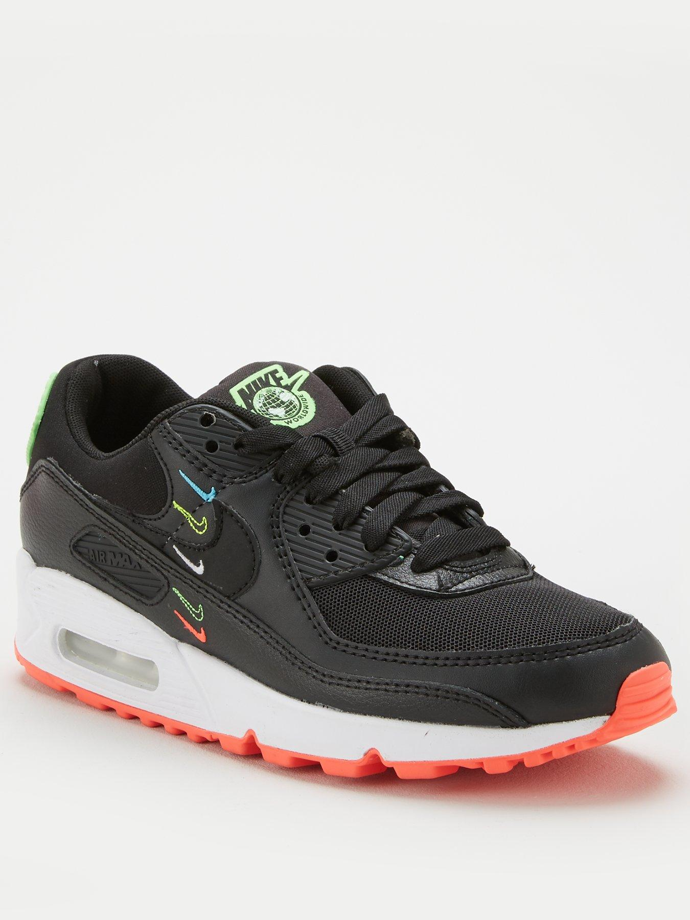 black nike shoes with green tick