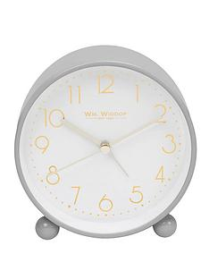 grey-metal-alarm-clock-with-gold-dial
