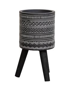ornate-black-planter-with-wooden-legs