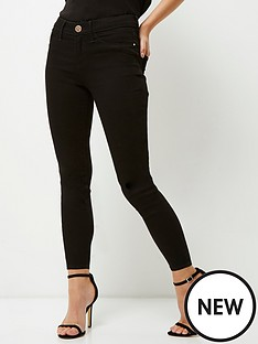 ri-petite-mid-rise-molly-jegging-black
