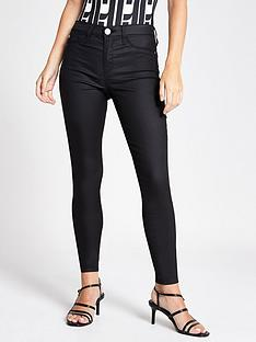 ri-petite-coated-mid-rise-molly-jegging-black