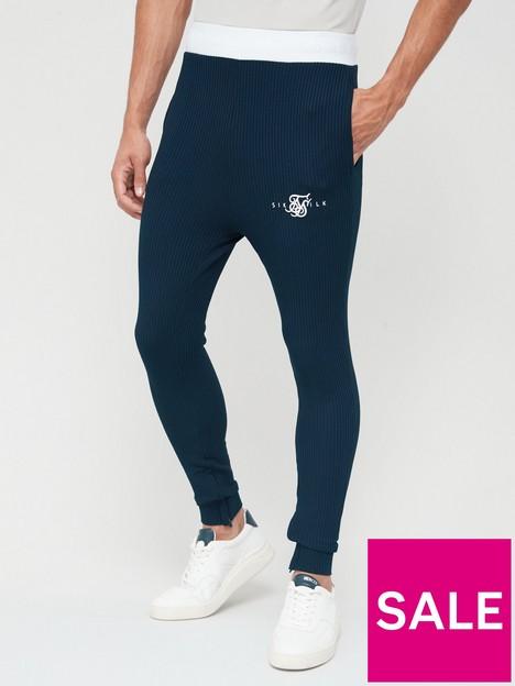 sik-silk-surface-track-pants-navy